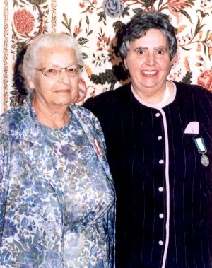 Photograph of Elsie Cressman and Patricia Legault. 1996, with Pat's Ontario Medal for Good Citizenship.